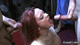 Redhead slut gets covered in jizz in bukkake porn